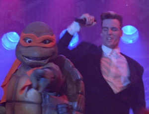 Vanilla Ice tries to take out Michaelangelo while he's not looking.