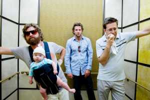 See, they're drunk in the elevator! And there's a baby with them! This is funny!